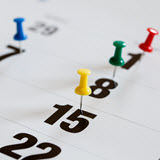Photo of 4 different color pushpins marking 4 dates on a calendar in 1 month. It is meant to be representative of how you               can enjoy free birthday meals throughout your birthday month, not just on the date of your birthday.               Click on the image to get to the article Eat Out for Free During Your Birthday Month.